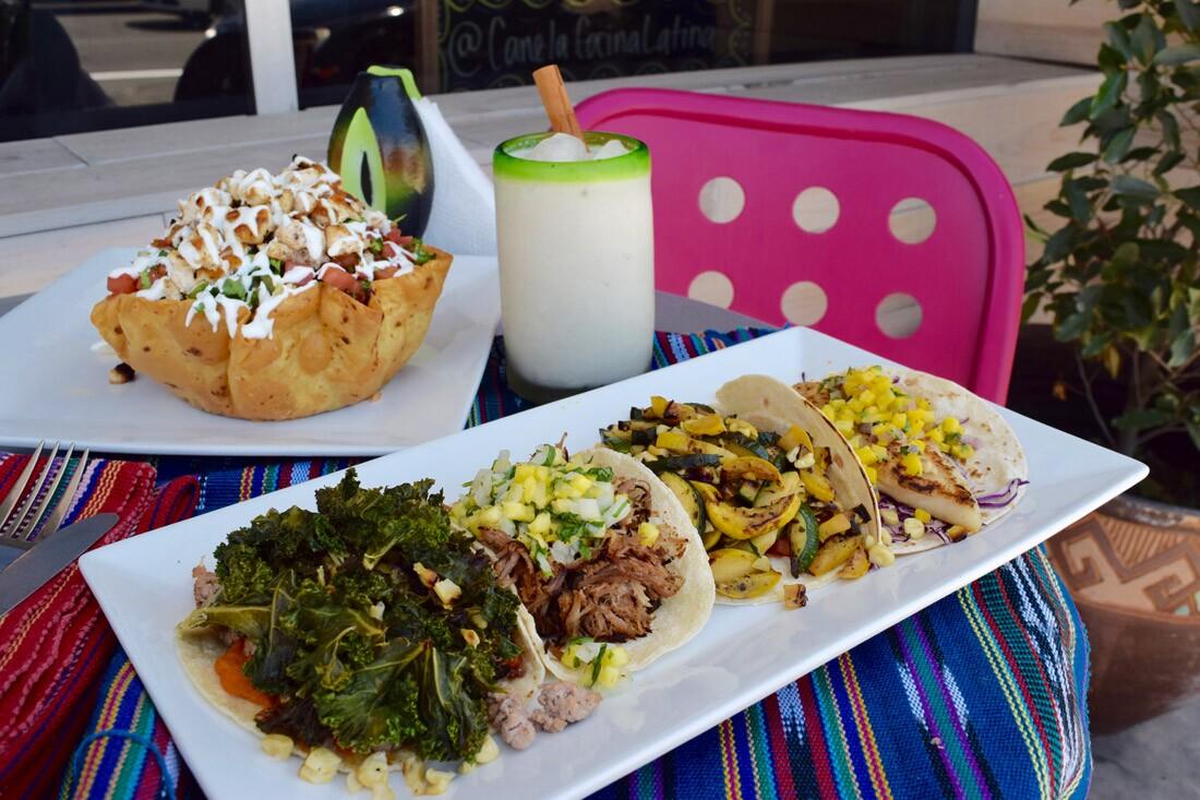 Soul, carnitas, calabacitas, and fish tacos with the tostada salad,Canela Cocina Latina|Danny Jensen