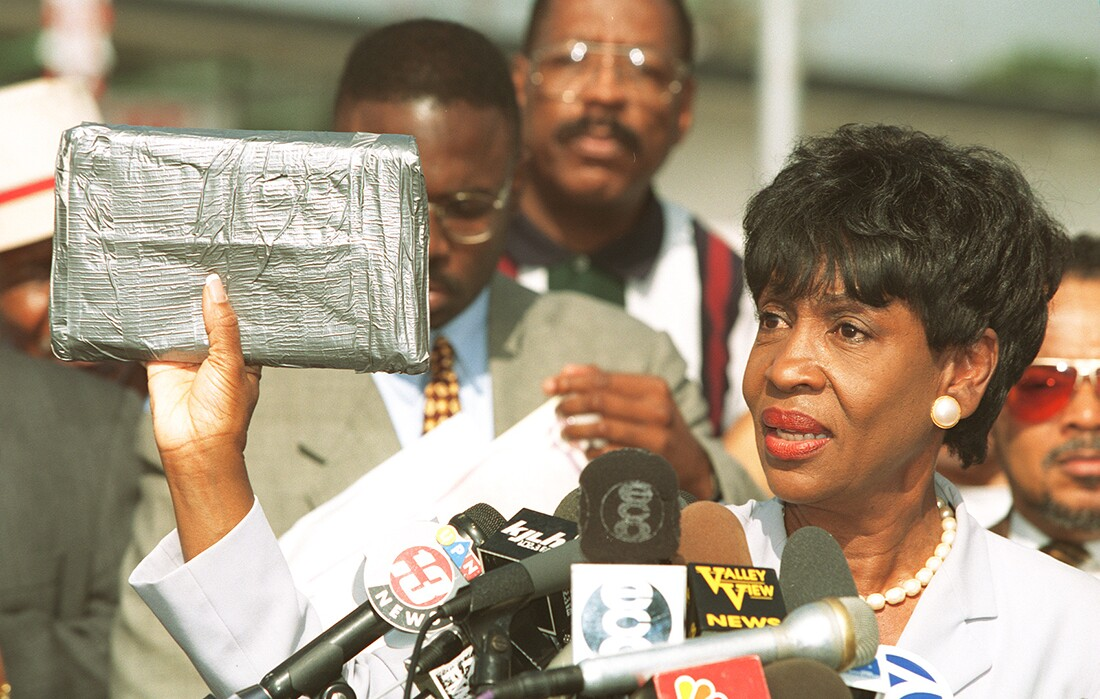 Congresswoman Maxine Waters at a press conference in South Central LA in 1996. She's holding up a taped package that shows how big a kilo of cocaine is. | Rick Meyer/Getty Images