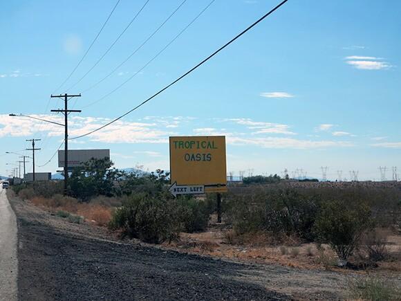 Sun weathered sign in the Mojave Desert, near Pearblossom, California. | Photo: Tyler Stallings.