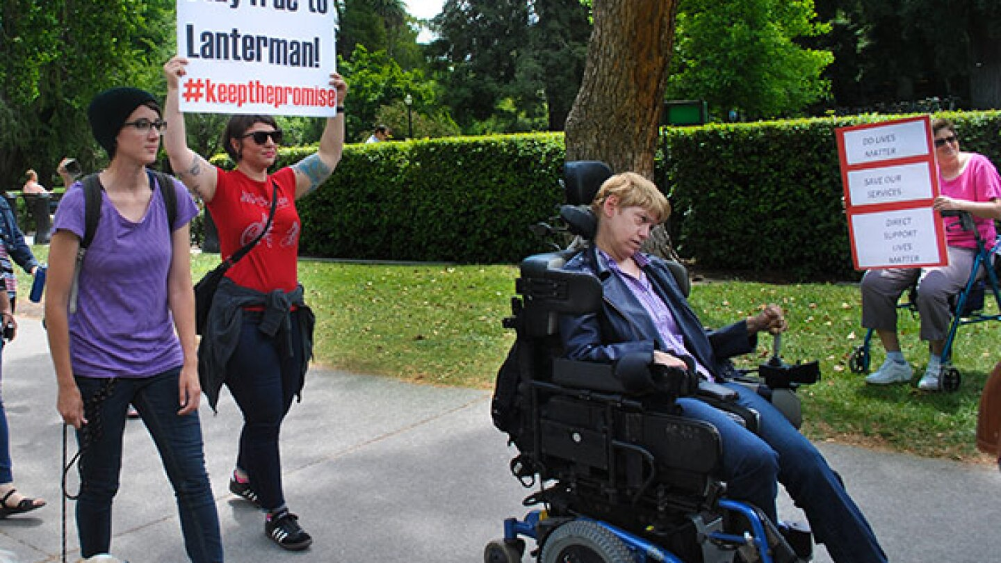 Disability rights advocates march to the State Capitol in Sacramento on May 18, 2015, urging lawmakers to increase funding for services and programs for individuals with developmental disabilities.