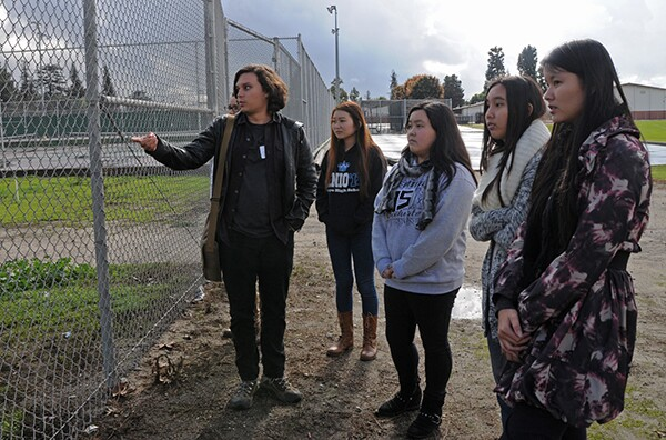 Bryan Slade and the students from Arroyo High School discuss the proposed garden site