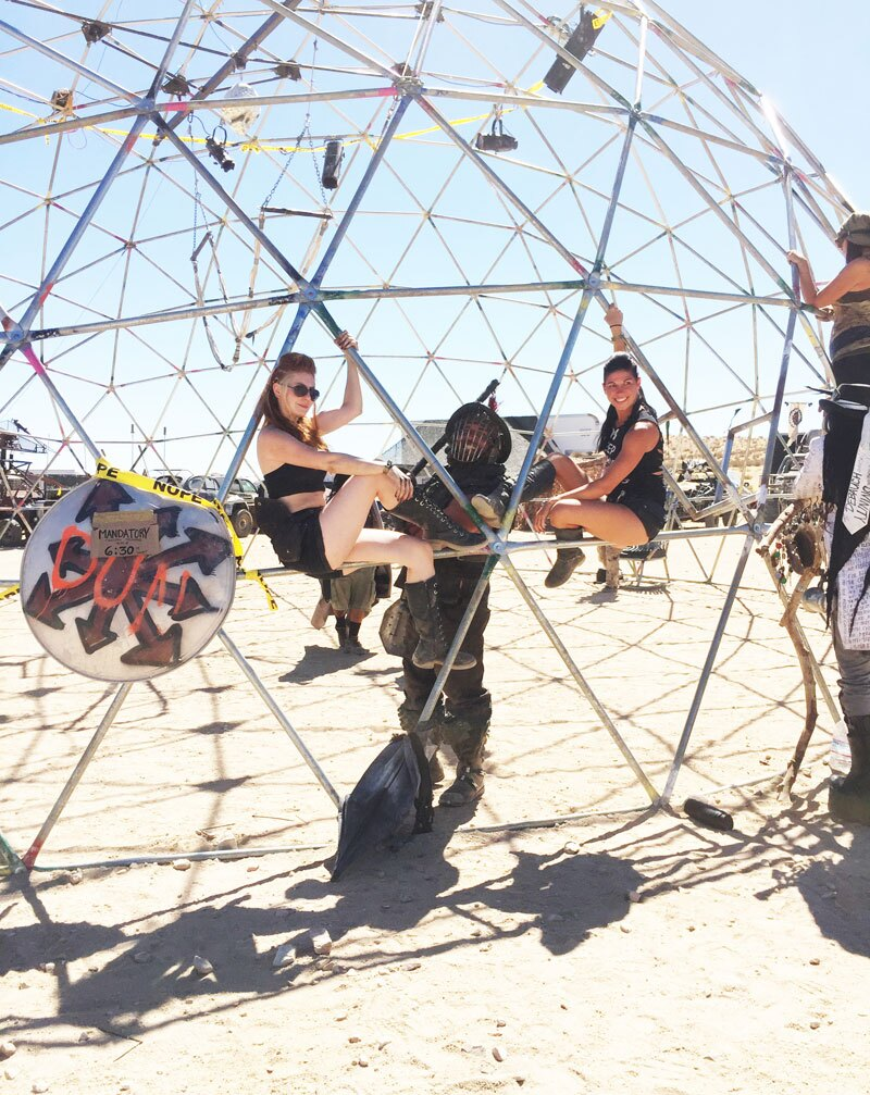 Warrior women and armor-clad men cling to the Thunderdome.