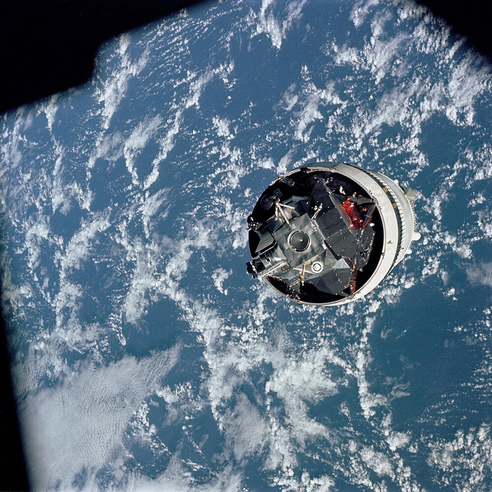 "Grumman's Lunar Module (LM) 3 ""Spider,"" still attached to the Saturn V third stage (McDonnell Douglas' S-IVB), is photographed from the Command/Service Module (CSM) ""Gumdrop"" on the first day of the Apollo 9 Earth-orbital mission. 