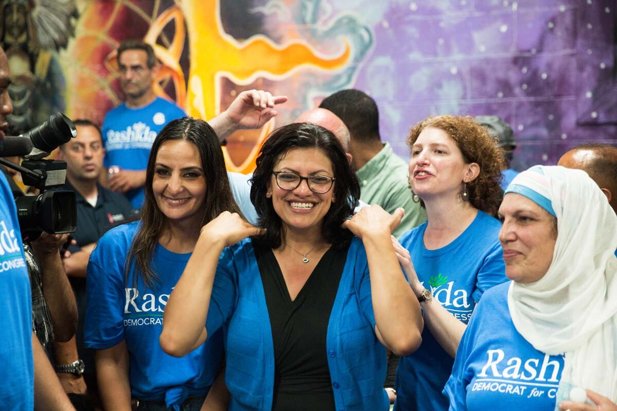 Rashida Tlaib, surrounded by her family and friends celebrates at her 2018 midterm primary election watch party, in Detroit, Michigan. | Erik Howard
