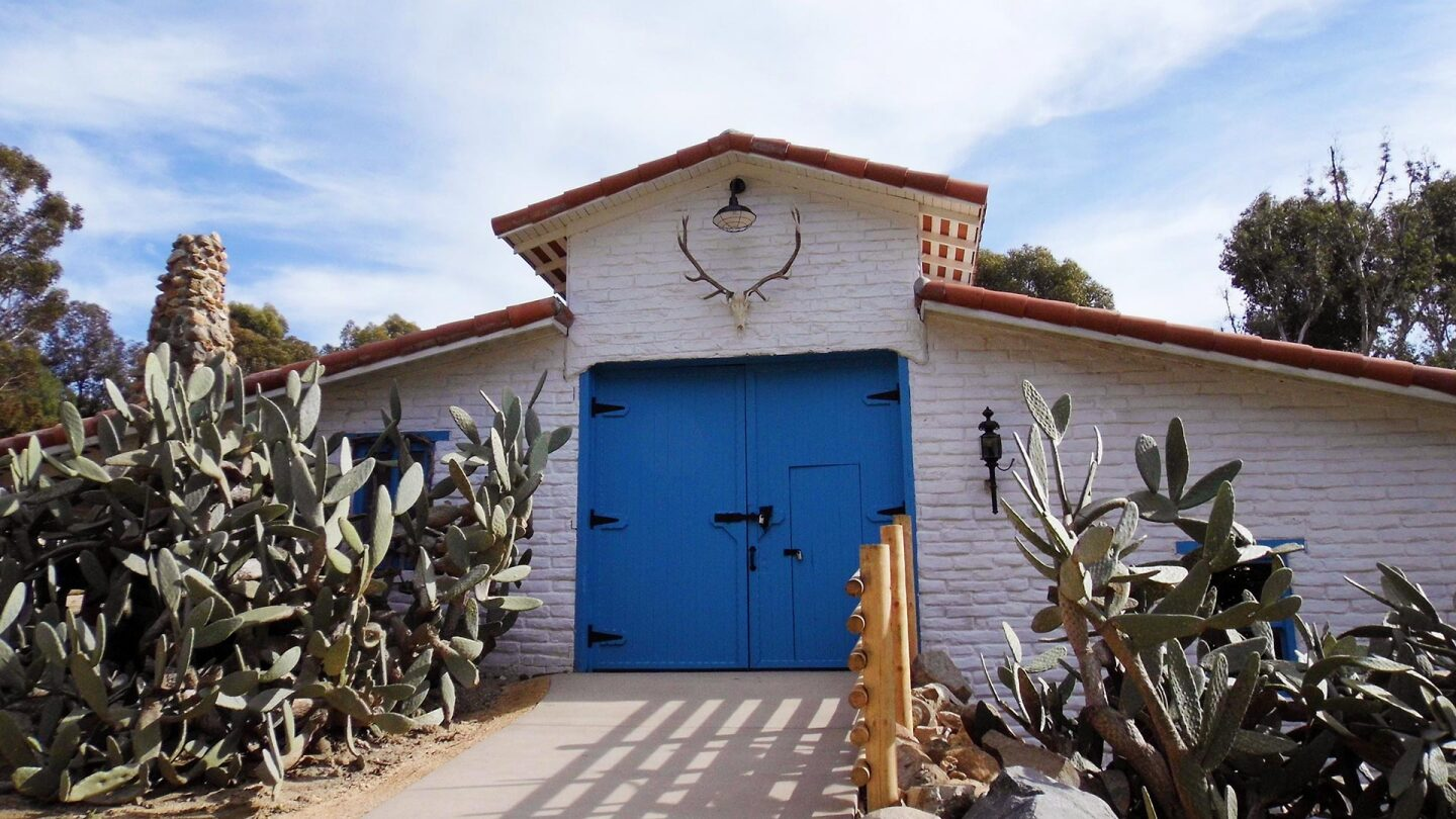 Shot of a barn with blue barndoors at the Leo Carrillo Ranch Historic Park.