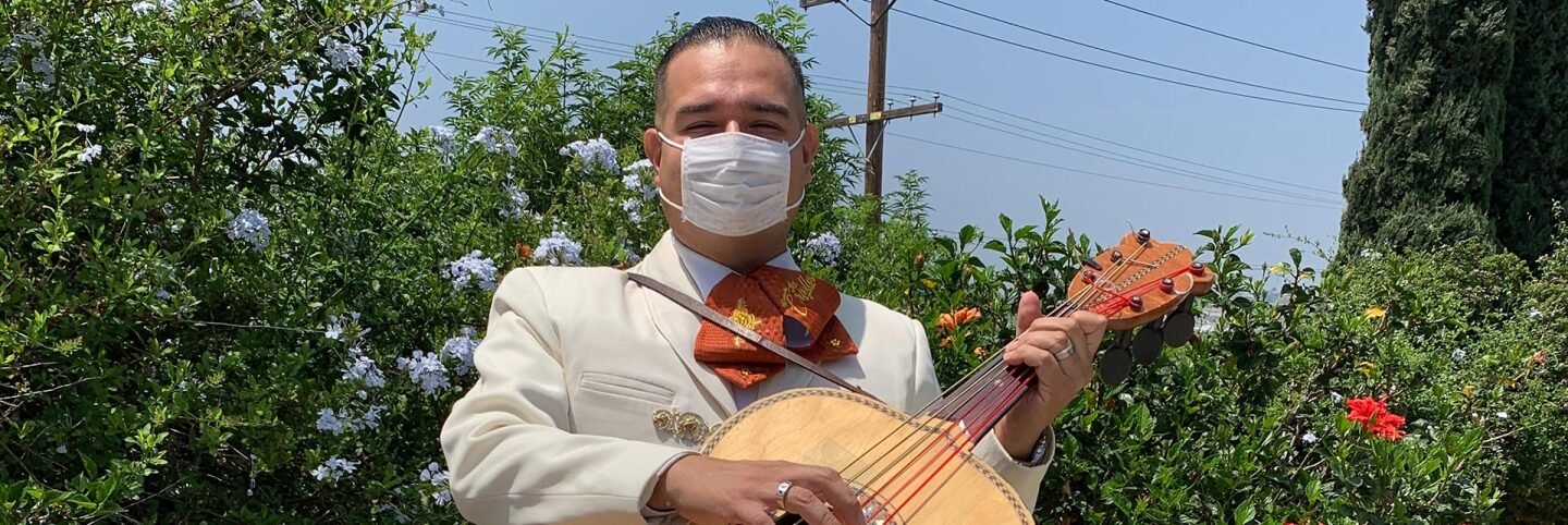 Joel Jacques of Mariachi Los Criollos de Guadalajara holds his guitarrón before a Los Angeles gig. | Courtesy of Joel Jacques