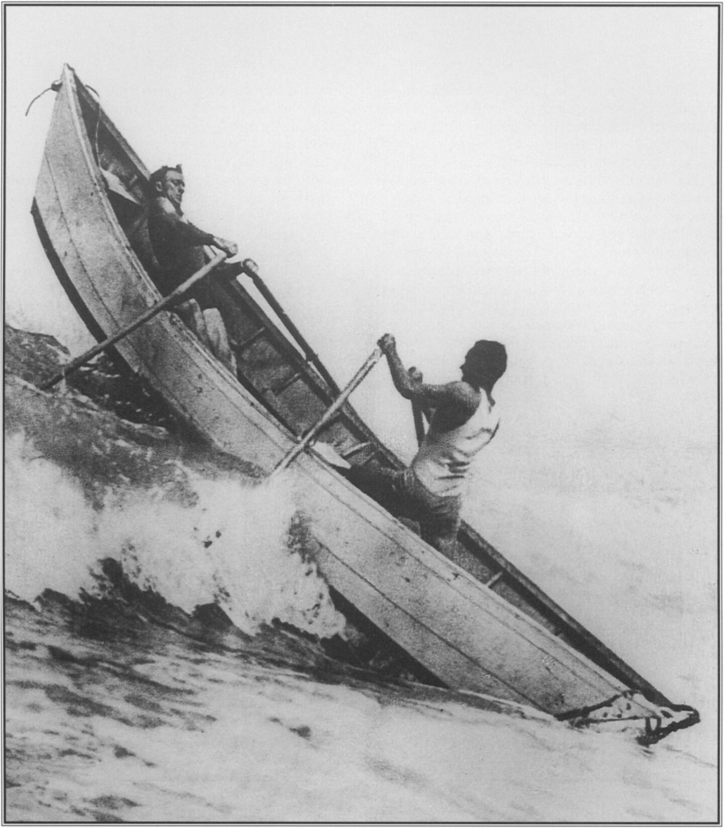 A consummate waterman, George Freeth at the bow, leaning into the effort, enjoyed rowing a quarter-ton dory through the surf to maintain his physical conditioning. With him is a fellow lifeguard  at  Redondo Beach in 1913. Courtesy Los Angeles County Life