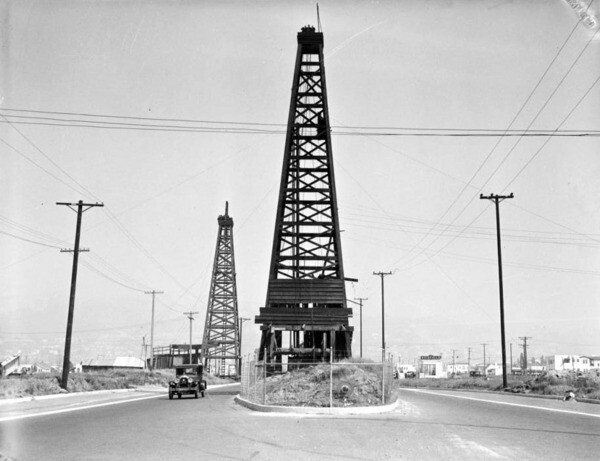 An oil well once stood in the middle of La Cienega Boulvevard. Courtesy of the USC Libraries - California Historical Society Collection.