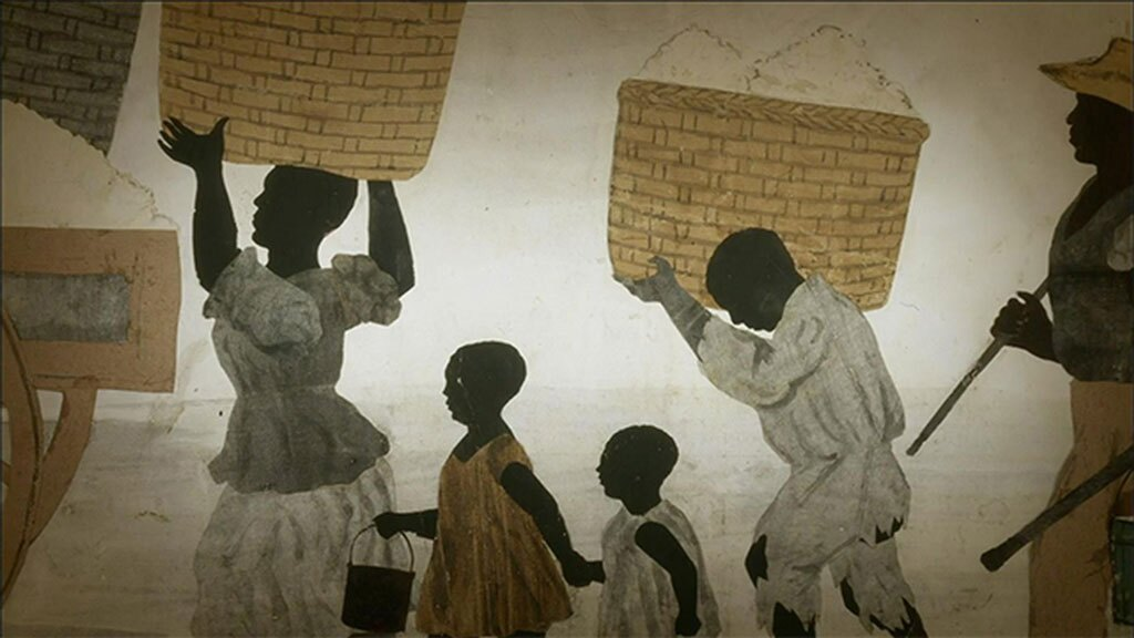 """An illustration depicting women and children carrying baskets above their heads. 