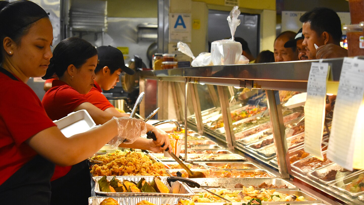 Arko Foods Market's workers serving customers in the turo-turo section.   Jacqueline Lee