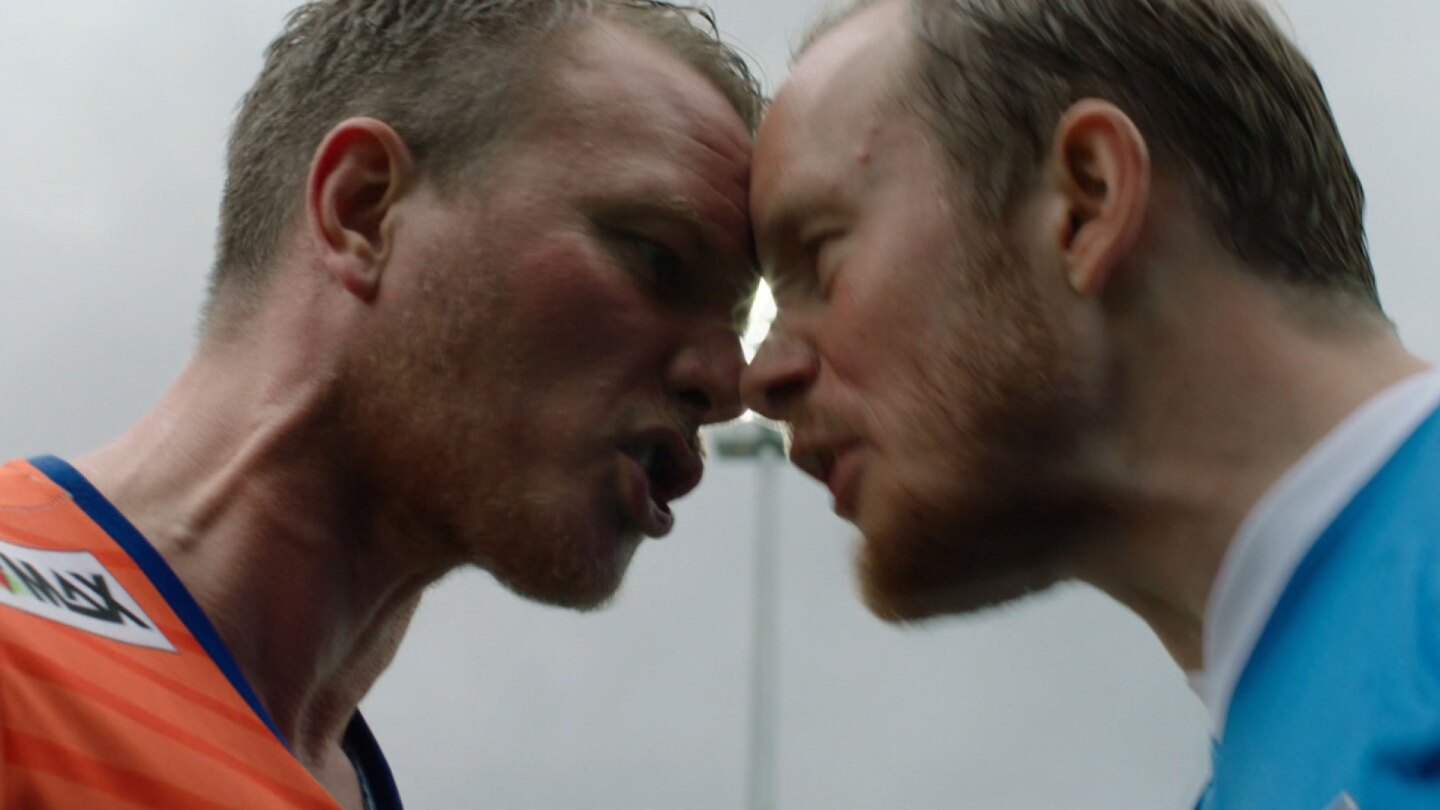 "Two men push their faces against each other in a heated spat.| ""Home Ground: Damn Alesund"""