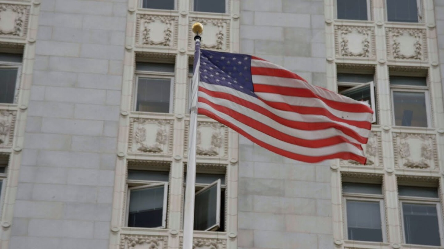 A flag of the U.S. flaps in the wind.