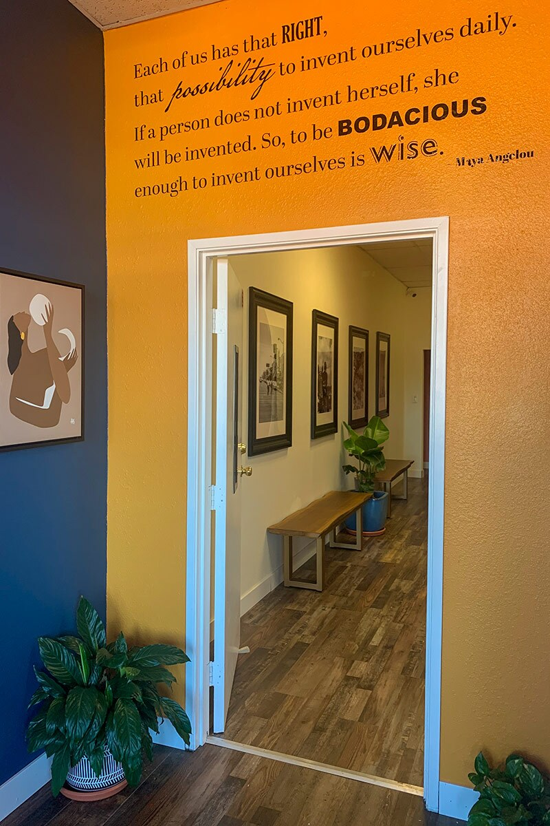 A Maya Angelou quote is painted over a doorway at Color Compton. | Courtesy of Color Compton