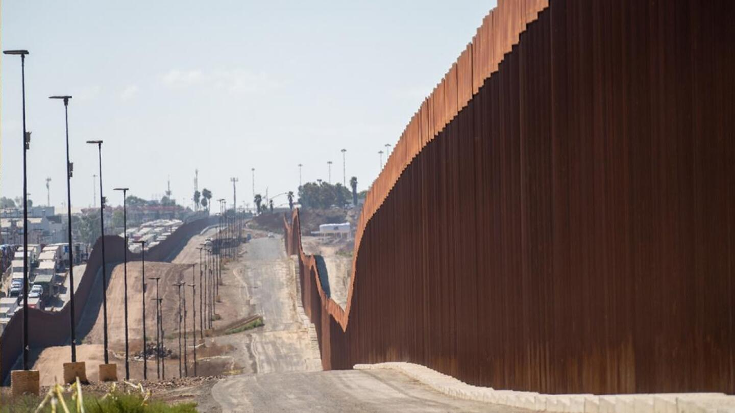 The border wall between the U.S. and Mexico stretches for many miles.