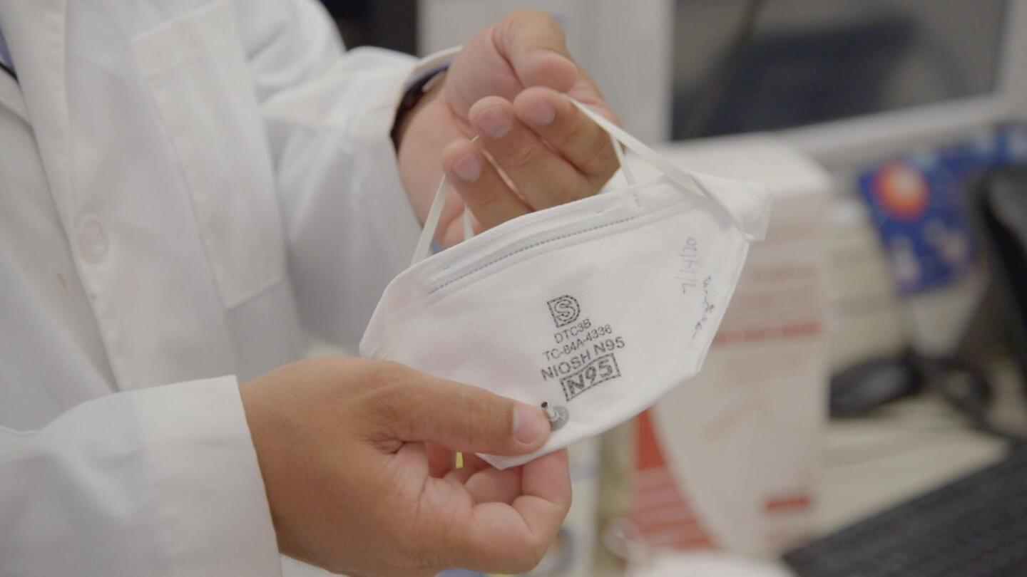 """An N95 mask being unfolded. 