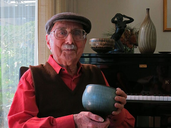 "Harrison McIntosh, sits in ""Sam's chair"" at his home in Claremont on January 15, 2014. He is holding a footed bowl he made in 1976. The chair was a gift made in 1961 by his good friend Sam Maloof. 
