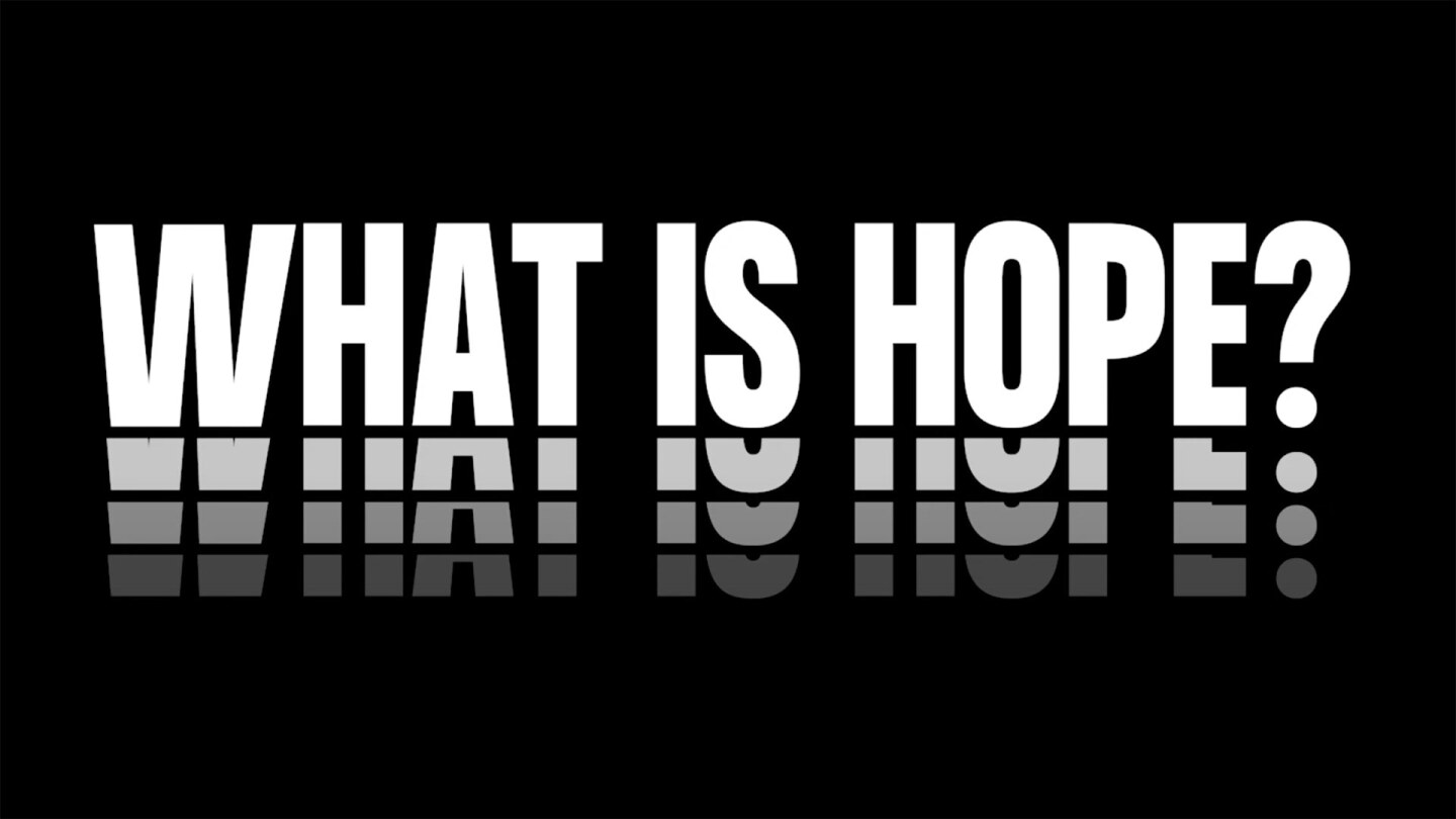 """The question """"WHAT IS HOPE?"""" in white text over black background. 