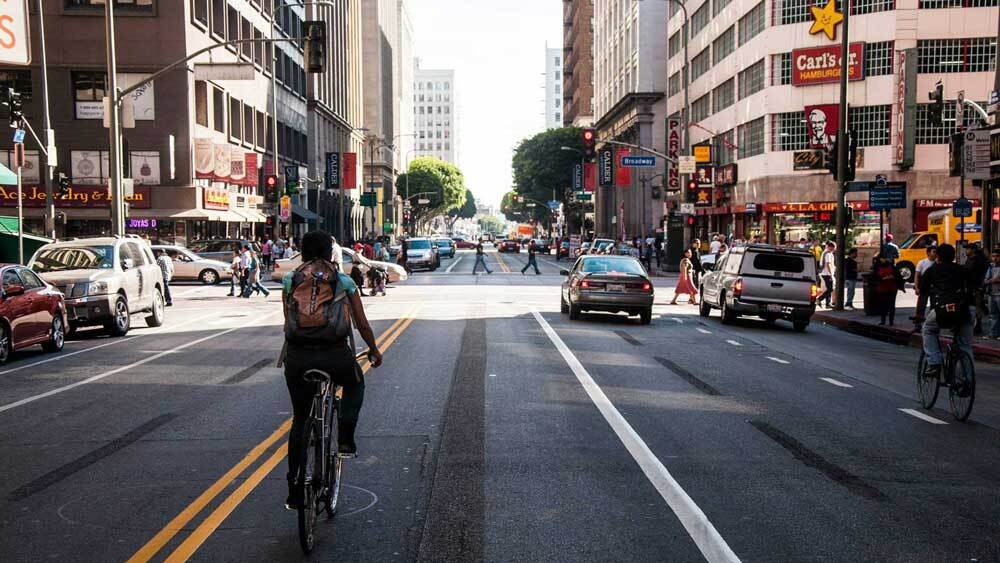 A biker riding through downtown Los Angeles. | Taylor Fitz-Gibbon