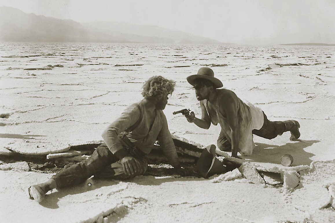 McTeague (Gibson Gowland) and Schouler (Jean Hersholt) brawl it out on the Death Valley's salt flats in Erich von Stroheim's 1924 silent film classic, Greed. Turner Entertainment.