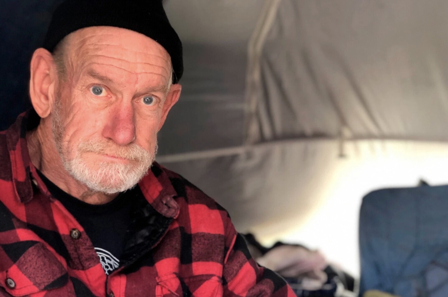 Kent Dull lives at the Here There encampment in Berkeley, California. | Cal Matters