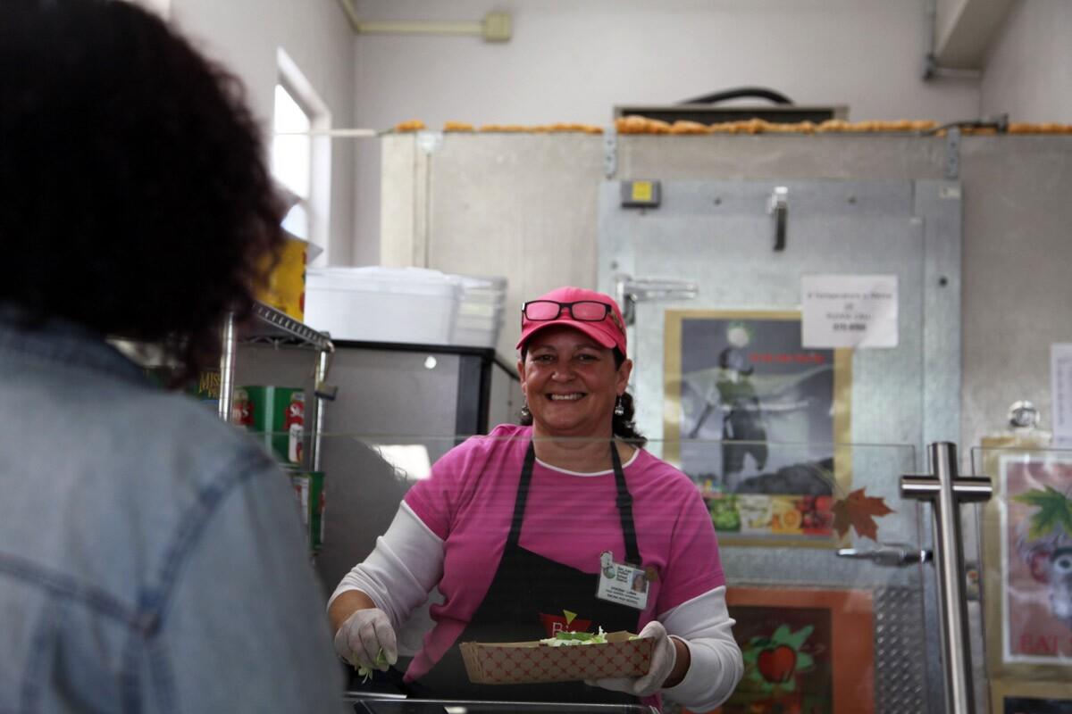 Deborah Luman serving salad