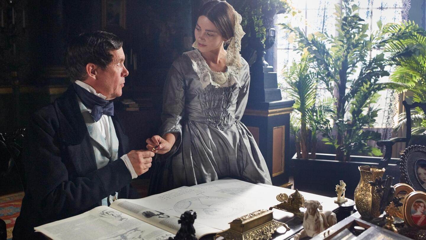 "Queen Victoria (Jenna Coleman) grabs a writing pen from King Leopold (Alex Jennings) as they face each other. | ""Victoria Season 3 on Masterpiece: A Coburg Quartet"""