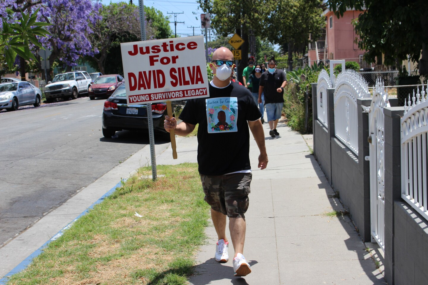 Chris Silva, whose brother died during struggle with Kern County Sheriff deputies, holds sign for his brother at George Floyd protest | Karen Foshay