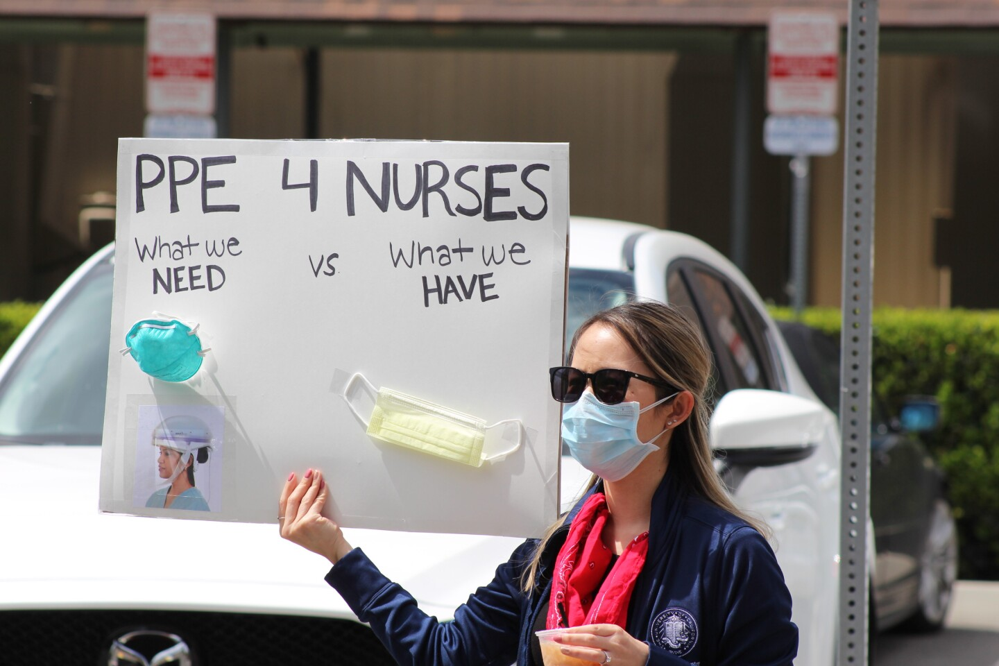 "Nurse holding sign ""PPE 4 Nurses"", during protest outside UCI Medical Center in Orange on Friday, April 3rd 