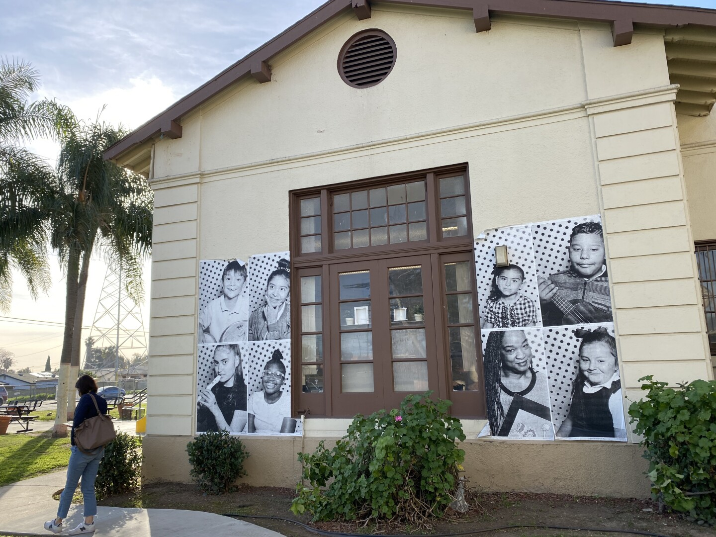 Posters of children and faculty rest on the side of McKinley K-8 School of Integrated Arts.
