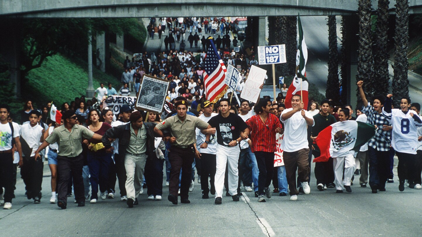 Hundreds of Fullerton College students march through Fullerton, California protesting Proposition 187 on November 2, 1994.   Bruce Chambers / MediaNews Group / Orange County Register via Getty Images