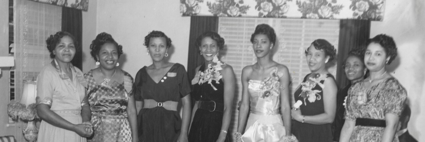 Les Uniques Social Club initiation ceremony of new officers at the Buckman home in Santa Monica, 1954. | Persil Lewis. Courtesy of the Quinn Research Center
