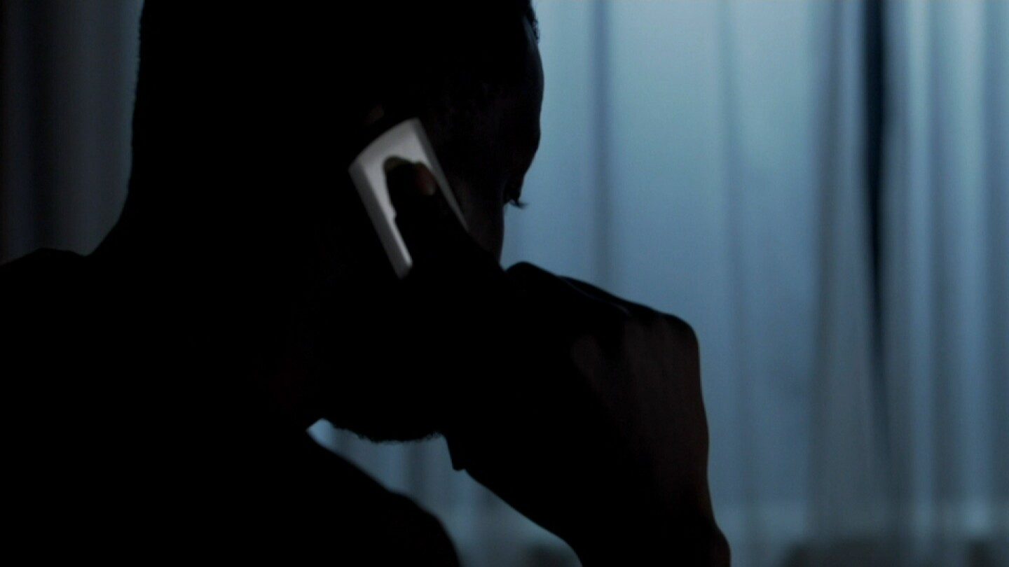 """Silhouette of a person involved in a scam. 