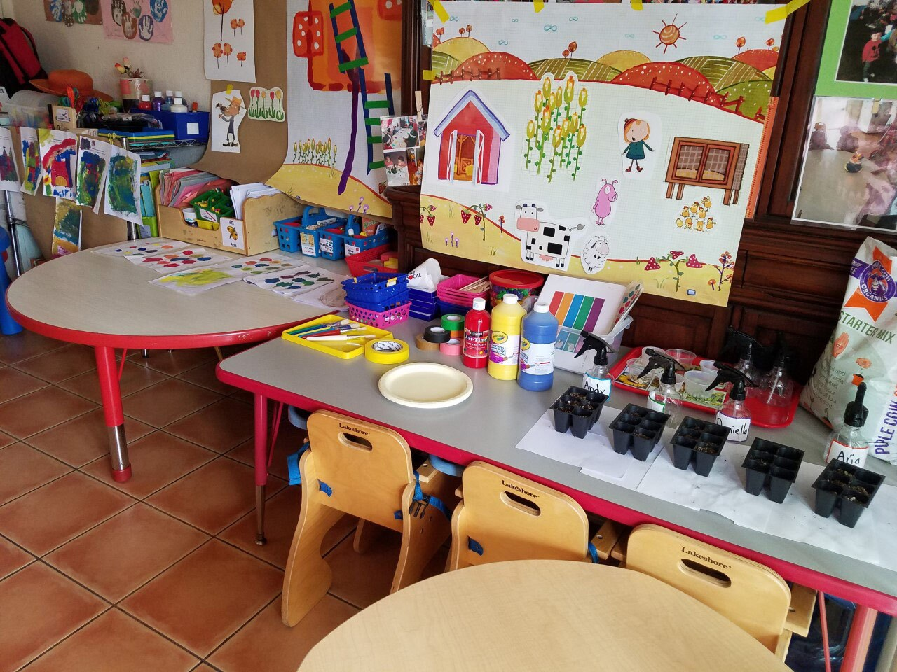 A small table at a day care is filled with materials for the pilot hybrid program for early math and science from PBS SoCal.