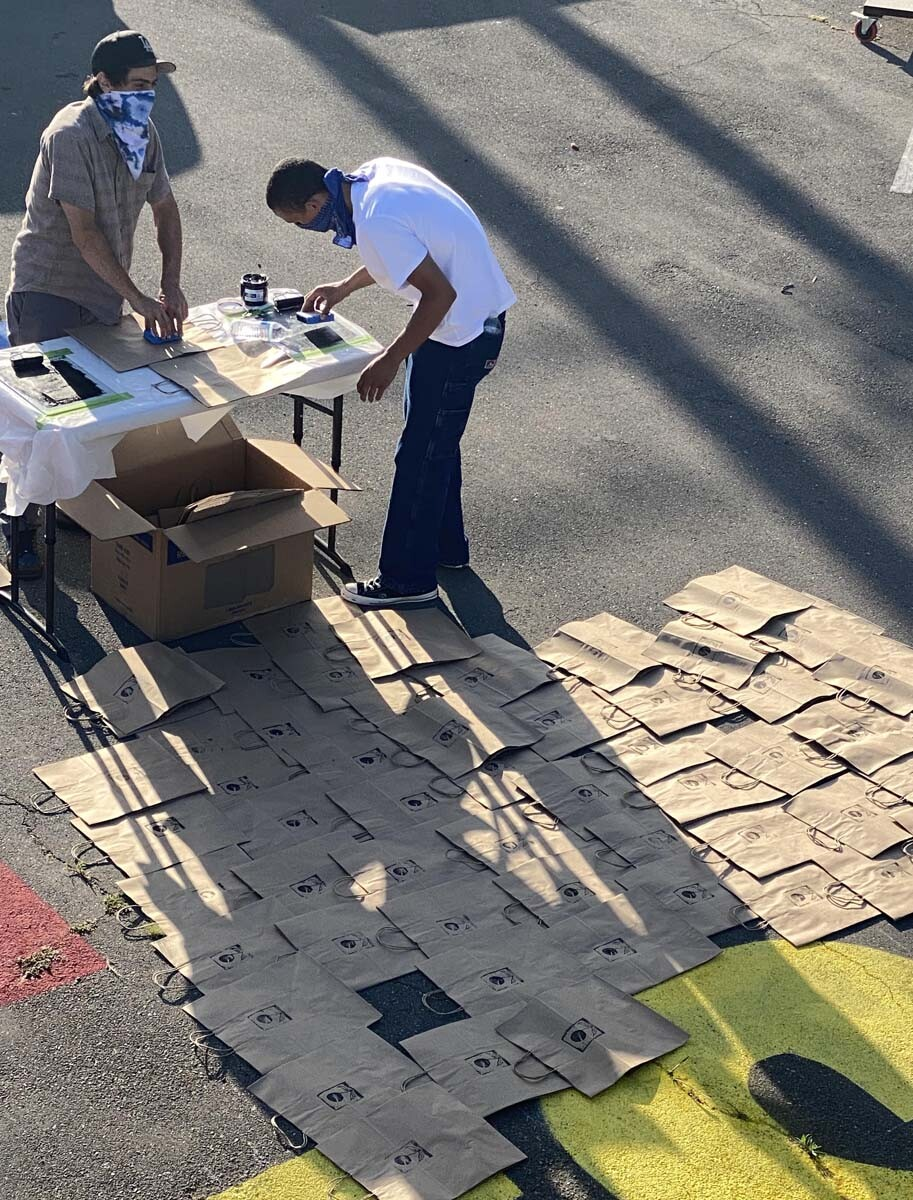 Volunteers prepare the art supply kits for high schoolers   Courtesy of Crenshaw Dairy Mart