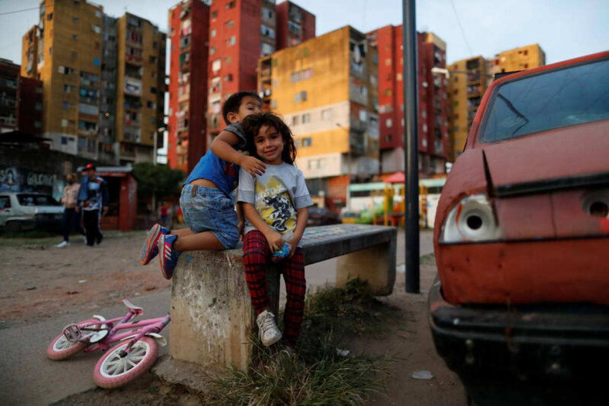 Children play during the spread of the coronavirus disease (COVID-19), at Fuerte Apache, on the outskirts of Buenos Aires, Argentina April 23, 2020. | REUTERS/Agustin Marcarian