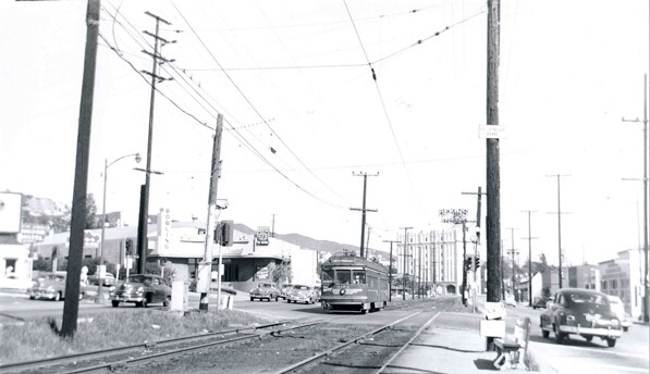 A streetcar travels down Santa Monica Boulevard where it intersects with La Cienega. 1952 photo courtesy of the Metro Transportation Library.