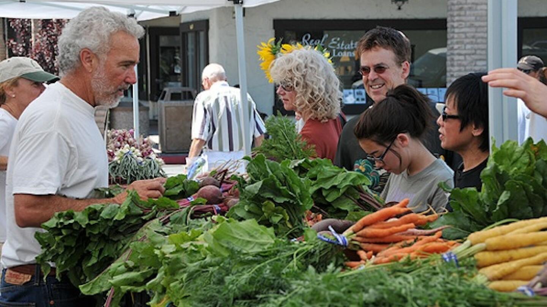 Phil McGrath (aka Farmer Phil) at a farmers market | Courtesy McGrath Family Farm
