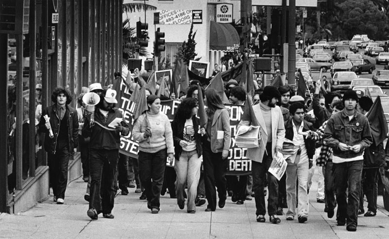 Millions of workers around the world observe May Day each year - the international holiday of organized labor. Like many before it, this May Day march along Wilshire Boulevard culminated in a rally at MacArthur Park, 1980.