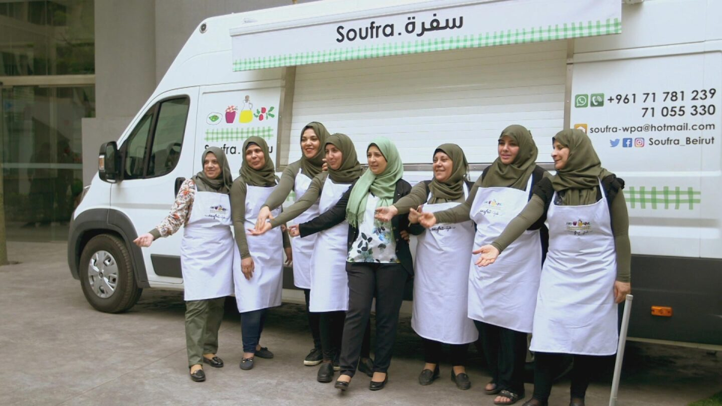 "A group of Palestinian women pose in front of their food truck called ""Soufra."" 