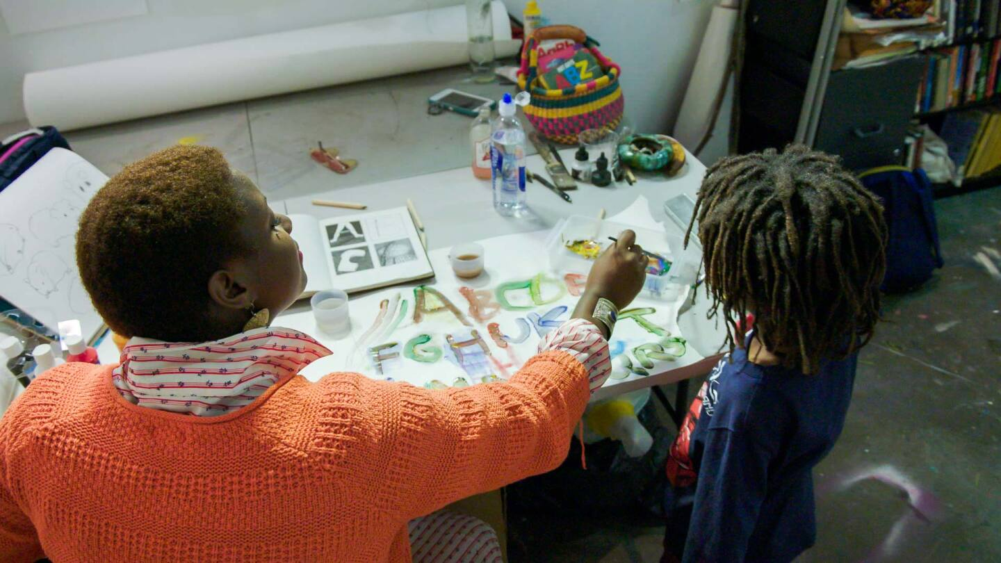 "Artist Kenyatta A.C. Hinkle with her son, Johari | Still from KCET Artbound's ""Artist and Mother"" Mother AB s9"