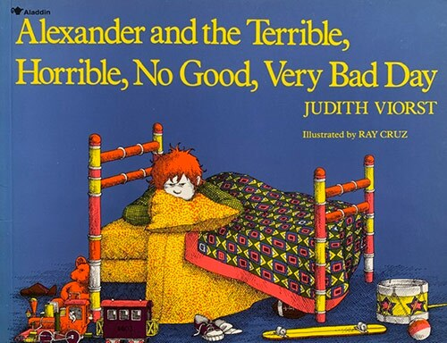 "Book cover of ""Alexander and the Terrible, Horrible, No Good, Very Bad Day"" written by Judith Viorst and illustrated by Ray Cruz featuring an illustration of an angry-looking little boy lying on his bed. 