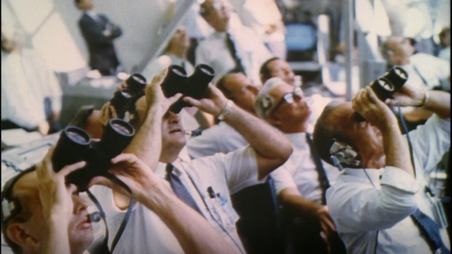 "Men from mission control watching Apollo 11 Launch with binoculars | Still from ""8 Days: To the Moon and Back"""