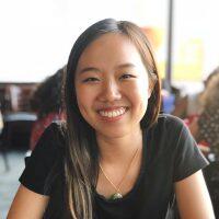 Portrait of Karen Ho at a restaurant.