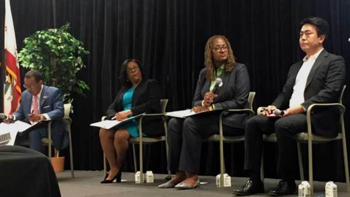 Four candidates for the second district of the Los Angeles County board of Supervisors on stage. | Chanté Griffin