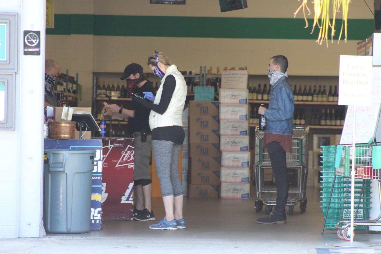 Customers check out at Beverage Warehouse   Karen Foshay