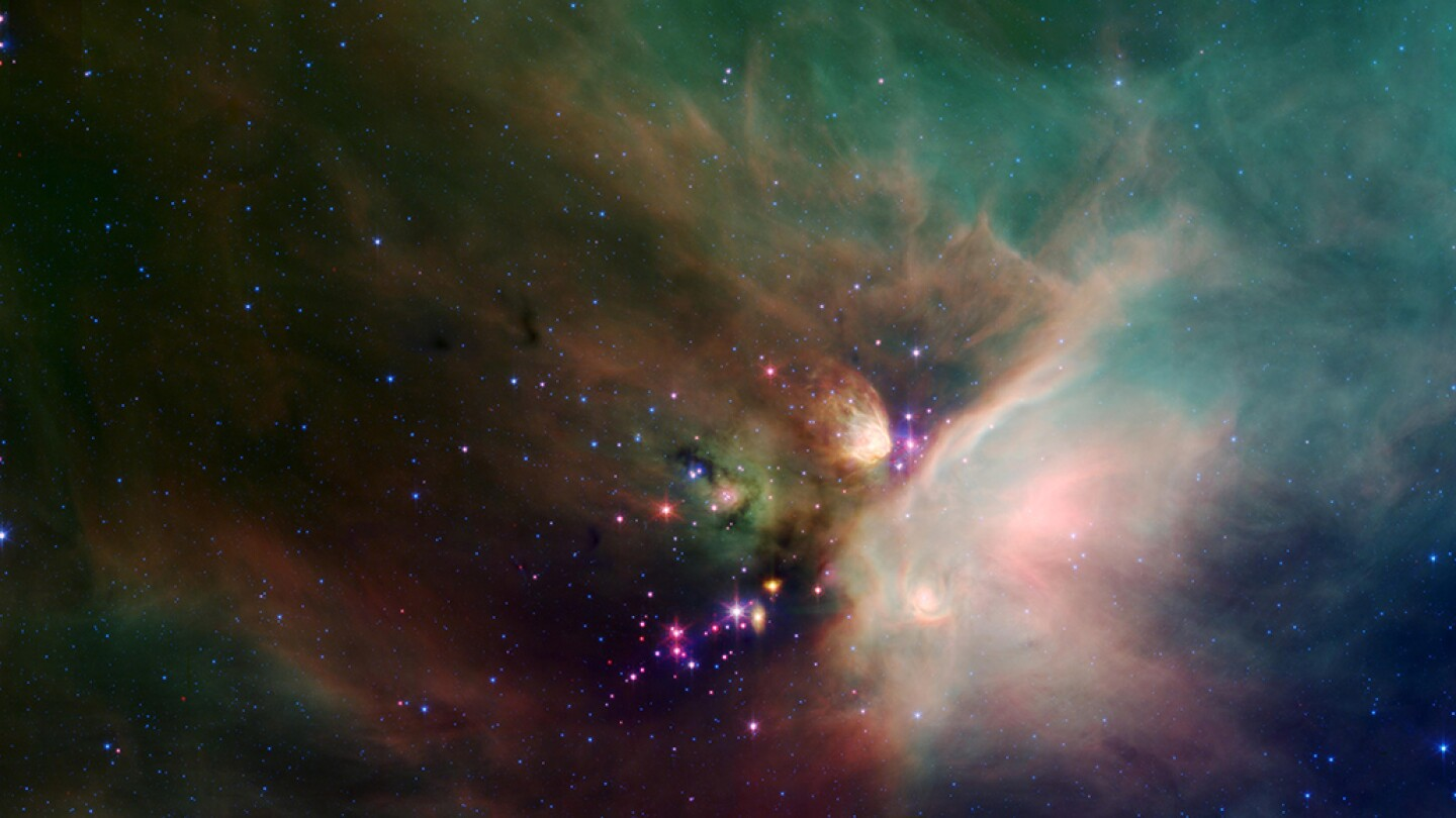 Newborn stars peek out from beneath their natal blanket of dust in this dynamic image of the Rho Ophiuchi dark cloud from NASA's Spitzer Space Telescope. | Flickr/NASA Marshall Space Flight Center/Creative Commons (CC BY-NC 2.0)