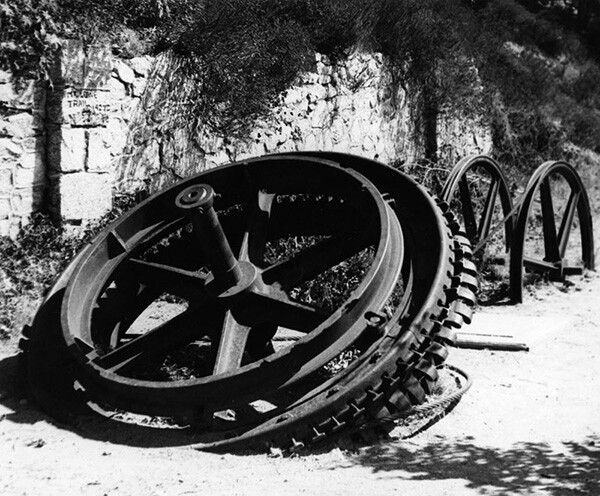 Shown here is a grip wheel, 9 feet in diameter, once part of the cable winding machinery located in the Echo Mountain cable house and used to pull the cable cars up and down the Incline portion of the railway. | Courtesy of the Los Angeles Public Library