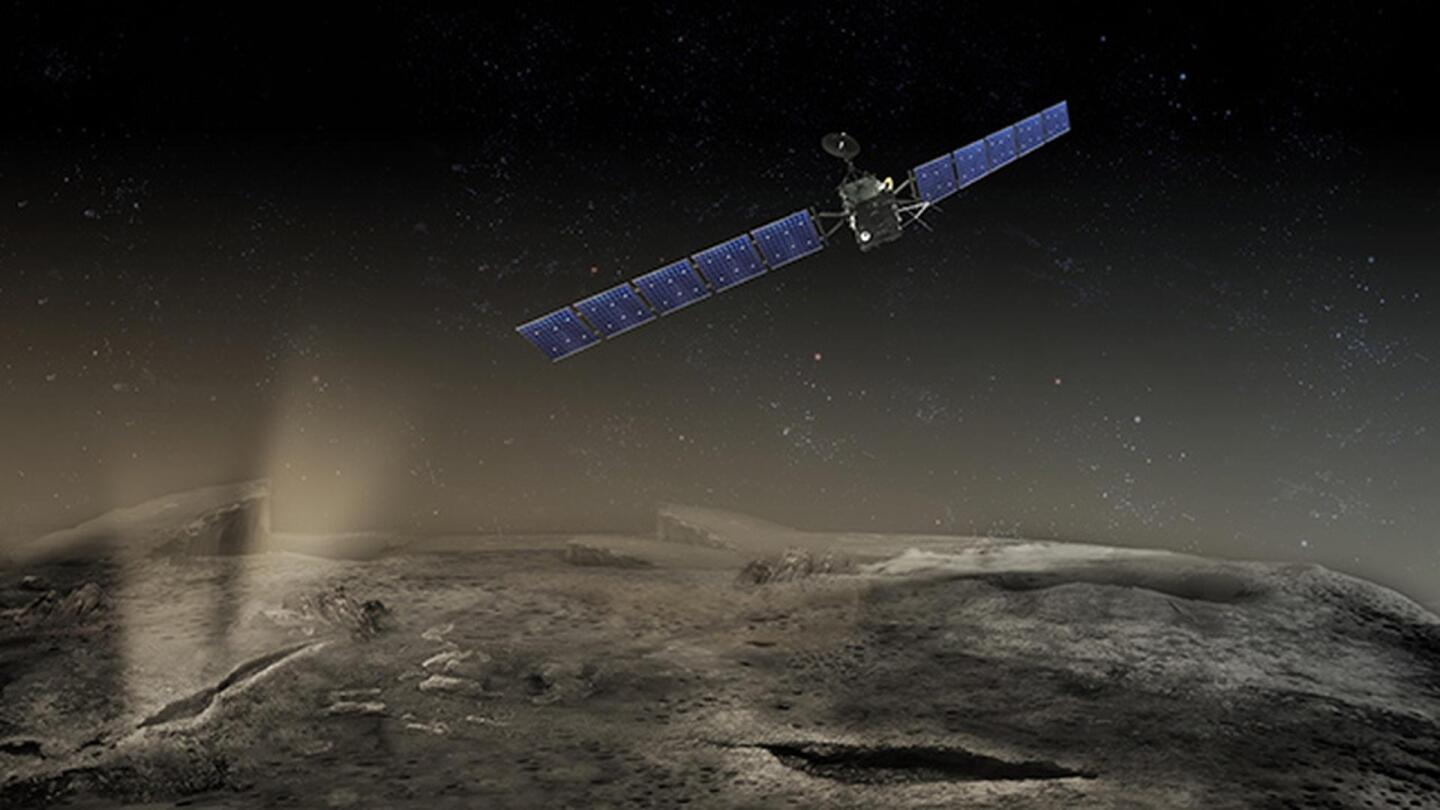 """Satellite hovering over a comet 