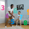 A father and small child dance in a living room as animated numbers 1-10 swirl around them.