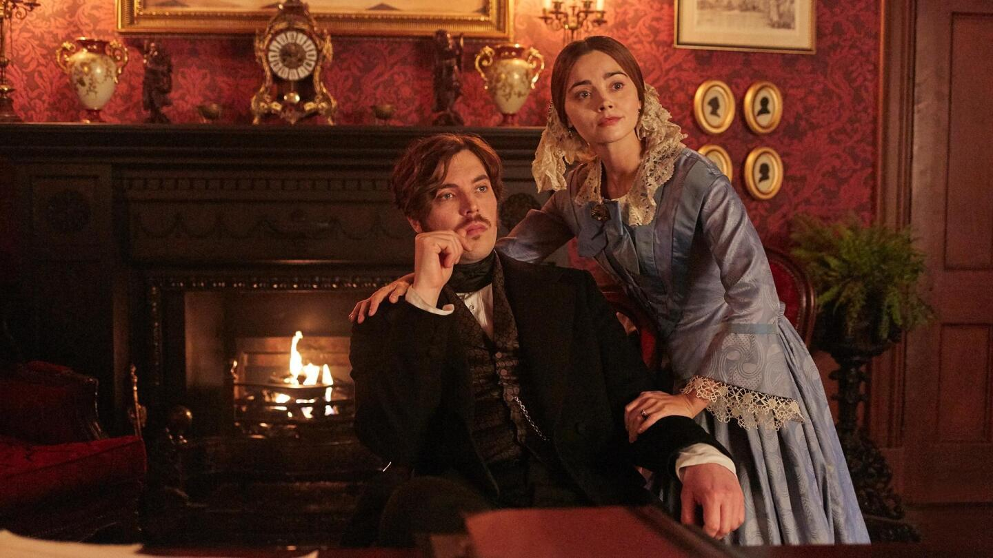 "Prince Albert (Tom Hughes) sits in a chair as Queen Victoria (Jenna Coleman) rests her hands on his arm and shoulder. | ""Victoria Season 3 on Masterpiece: A Public Inconvenience"""